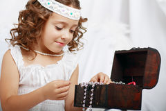 Beautiful little girl plays Stock Photography