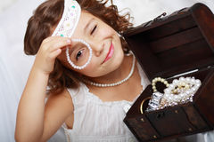 Beautiful little girl plays Royalty Free Stock Images