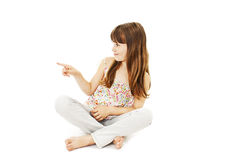 Beautiful little girl pointing with finger Royalty Free Stock Image