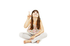 Beautiful little girl pointing with finger. Isolated on white background stock photos