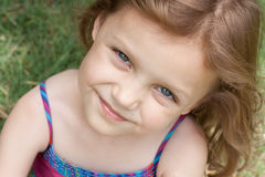 Beautiful little girl portrait. Beautiful little girl looking up and smiling Stock Photography
