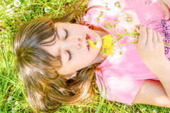 Beautiful Little girl portrait with dandelion in her hand. Little girl portrait with dandelion in her hand Royalty Free Stock Photo
