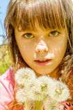 Beautiful Little girl portrait with dandelion in her hand Stock Image