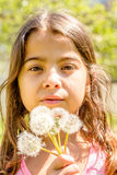 Beautiful Little girl portrait with dandelion in her hand Stock Photo