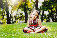 Beautiful little girl portrait in a summer green park Royalty Free Stock Photos