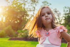 Beautiful little girl posing outdoors Stock Images