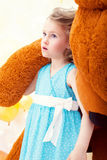 Beautiful little girl posing with teddy bear Royalty Free Stock Image