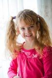 Beautiful little girl posing Stock Images