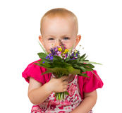 Beautiful little girl with a posy of flowers. Beautiful little blond girl with a posy of fresh garden flowers held in front of her face peering over the top with Stock Photos