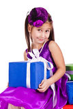 Beautiful little girl with presents Royalty Free Stock Photos