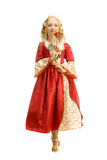Beautiful  Little Girl in Princess Costume Standing With red Ros. Beautiful Little Girl With Long Blonde Hair in the Princess Costume Holding a Red Rose at the Royalty Free Stock Images