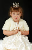 Beautiful little girl with princess crown Stock Photo