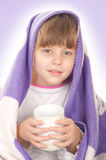Beautiful little girl with a purple blanket Royalty Free Stock Image