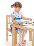 Beautiful little girl reading a book. Royalty Free Stock Photography