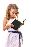 Beautiful little girl reading a book Stock Photos