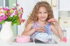 Beautiful little girl reading magazine Royalty Free Stock Photos
