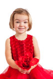 Beautiful little girl in red. With red flower for her Mom Stock Photos