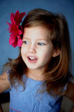 Beautiful little girl with the red barrette in the shape of a flower in the hair Stock Images