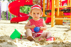 Beautiful little girl in red clothes, playing Royalty Free Stock Photos
