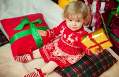 Beautiful little girl in red dress. With toys Royalty Free Stock Image