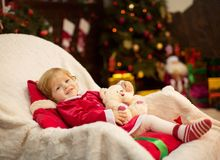 Beautiful little girl in red dress. With toys Stock Photography