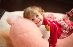 Beautiful little girl in red dress. With toys Stock Images