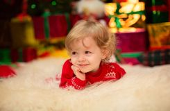 Beautiful little girl in red dress. With toys Royalty Free Stock Images