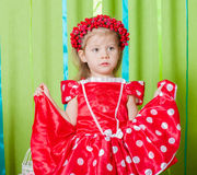 Beautiful little girl in a red dress Royalty Free Stock Images
