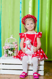 Beautiful little girl in a red dress Stock Photography