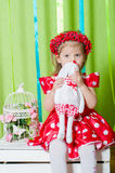 Beautiful little girl in a red dress Stock Photo