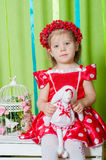 Beautiful little girl in a red dress Royalty Free Stock Photos