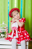 Beautiful little girl in a red dress Stock Images
