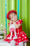 Beautiful little girl in a red dress Royalty Free Stock Image