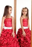 Beautiful little girl in red evening dress Stock Image