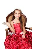 Beautiful little girl in red evening dress Royalty Free Stock Image