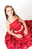 Beautiful little girl in red evening dress Royalty Free Stock Photography