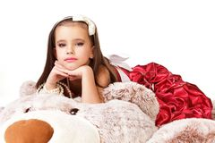Beautiful little girl in red evening dress Royalty Free Stock Photo