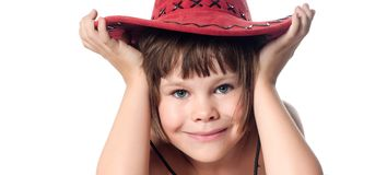 Beautiful little girl in a red hat Royalty Free Stock Images