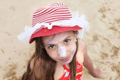 Beautiful little girl with hat posing on the beach Stock Photography