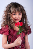 Beautiful little girl with red rose Royalty Free Stock Images