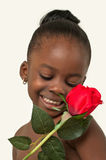 Beautiful little girl with red rose Royalty Free Stock Photo