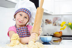 Beautiful little girl with rolling pin Stock Photography