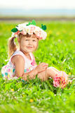 Beautiful little girl with a rose in his hand and a wreath of ro Stock Photography