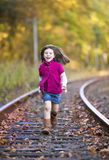 Beautiful little girl running Stock Photos