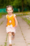Beautiful little girl runs. On path Stock Images