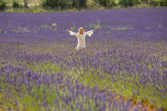 Beautiful little girl runs in a field of lavender Royalty Free Stock Photography