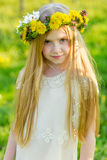 A beautiful little girl runs through a flowering garden in the s Royalty Free Stock Image