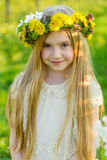 A beautiful little girl runs through a flowering garden in the s Royalty Free Stock Photo
