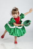 Beautiful little girl on Saint Patrick's Day. Full length portrait of an adorable little girl wearing green outfit and hat for Saint Patrick's Day, studio image Stock Photo