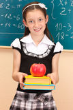 Beautiful little girl in school uniform Royalty Free Stock Photography